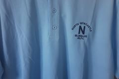 Norths light blue polo shirt.
